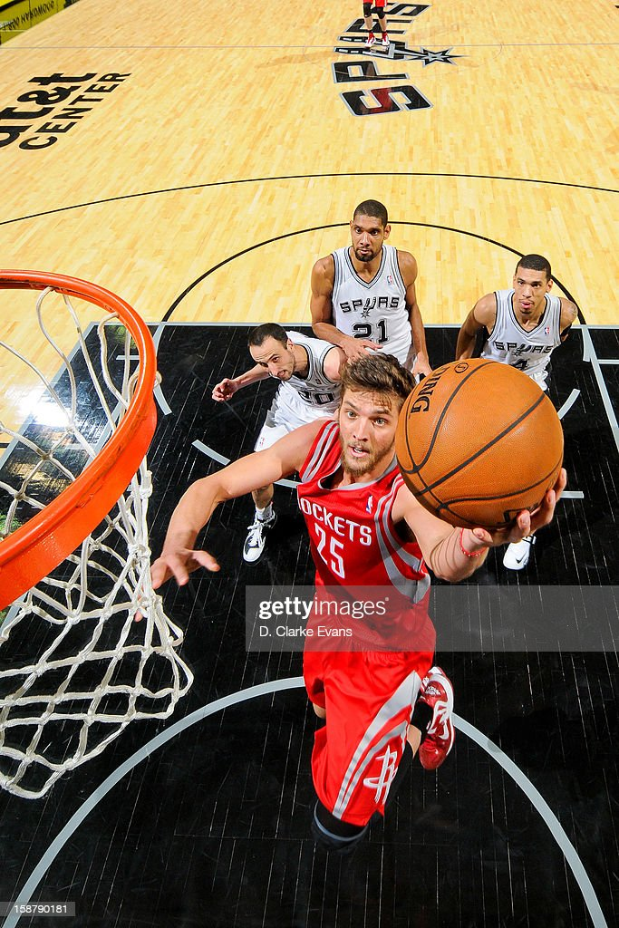 Chandler Parsons #25 of the Houston Rockets shoots a layup against the San Antonio Spurs on December 28, 2012 at the AT&T Center in San Antonio, Texas.