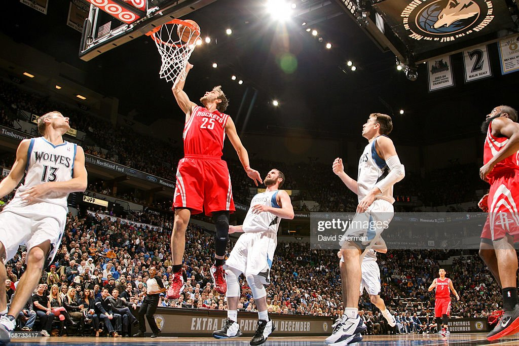 Chandler Parsons #25 of the Houston Rockets shoots a layup ahead of Kevin Love #42 of the Minnesota Timberwolves on December 26, 2012 at Target Center in Minneapolis, Minnesota.