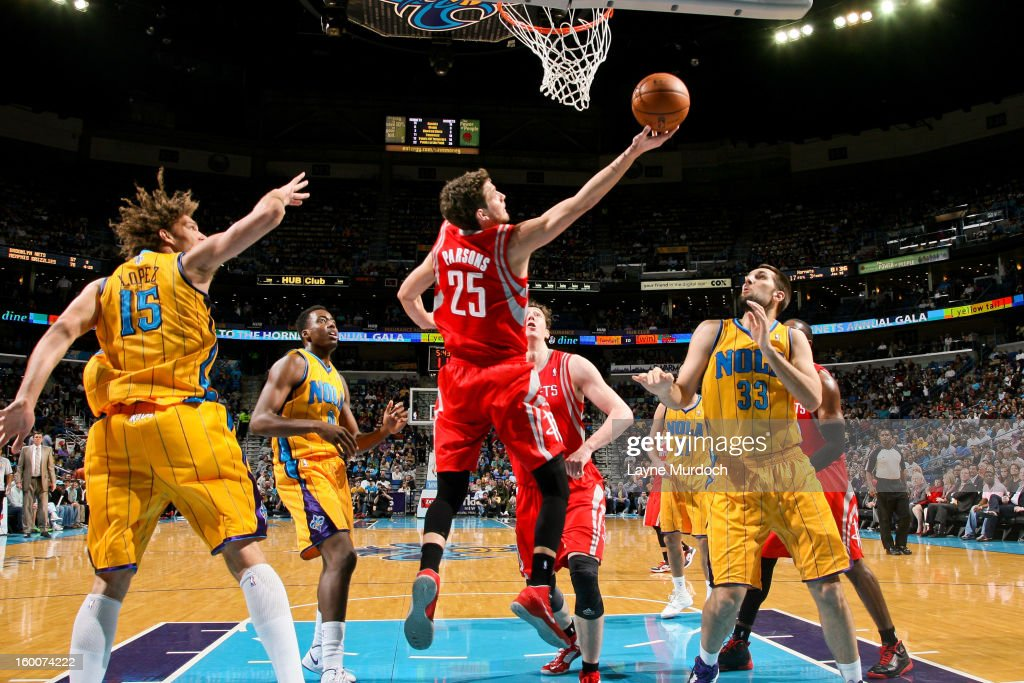 <a gi-track='captionPersonalityLinkClicked' href=/galleries/search?phrase=Chandler+Parsons&family=editorial&specificpeople=4249869 ng-click='$event.stopPropagation()'>Chandler Parsons</a> #25 of the Houston Rockets shoots a reverse layup against <a gi-track='captionPersonalityLinkClicked' href=/galleries/search?phrase=Robin+Lopez&family=editorial&specificpeople=2351509 ng-click='$event.stopPropagation()'>Robin Lopez</a> #15 and Ryan Anderson #33 of the New Orleans Hornets on January 25, 2013 at the New Orleans Arena in New Orleans, Louisiana.