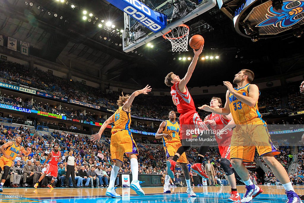<a gi-track='captionPersonalityLinkClicked' href=/galleries/search?phrase=Chandler+Parsons&family=editorial&specificpeople=4249869 ng-click='$event.stopPropagation()'>Chandler Parsons</a> #25 of the Houston Rockets shoots a reverse layup against Ryan Anderson #33 of the New Orleans Hornets on January 25, 2013 at the New Orleans Arena in New Orleans, Louisiana.