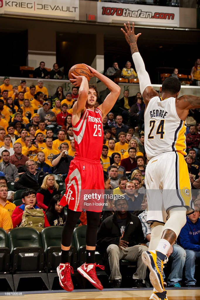 Chandler Parsons #25 of the Houston Rockets shoots a three-pointer against Paul George #24 of the Indiana Pacers on January 18, 2013 at Bankers Life Fieldhouse in Indianapolis, Indiana.