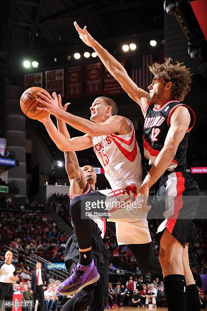 Chandler Parsons of the Houston Rockets shoots against Robin Lopez of the Portland Trail Blazers on January 20 2014 at the Toyota Center in Houston...
