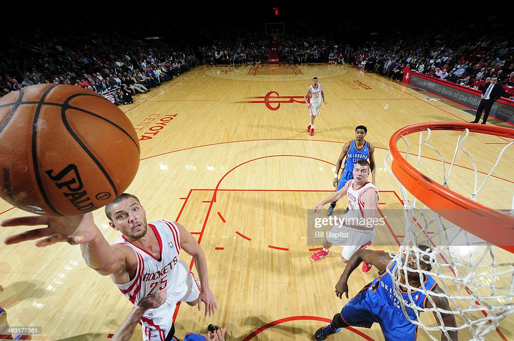 Chandler Parsons #25 of the Houston Rockets shoots against the Oklahoma City Thunder on January 16, 2014 at the Toyota Center in Houston, Texas.