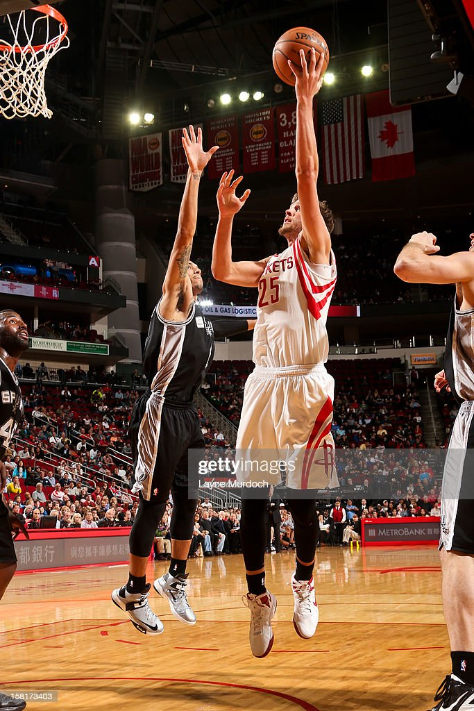 Chandler Parsons #25 of the Houston Rockets shoots in the lane against Danny Green #4 of the San Antonio Spurs on December 10, 2012 at the Toyota Center in Houston, Texas.