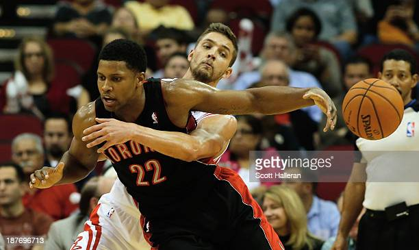 Chandler Parsons of the Houston Rockets steals the ball from Rudy gay of the Toronto Raptors at Toyota Center on November 11 2013 in Houston Texas...