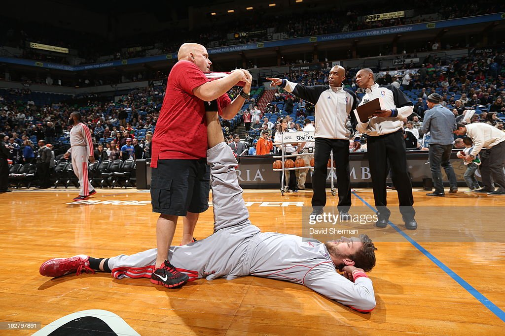 Chandler Parsons #25 of the Houston Rockets stretches before the game against the Minnesota Timberwolves on December 26, 2012 at Target Center in Minneapolis, Minnesota.