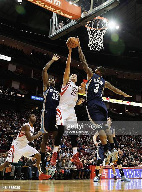 Chandler Parsons of the Houston Rockets takes a shot against Ed Davis James Johnson of the Memphis Grizzlies during the game at the Toyota Center on...