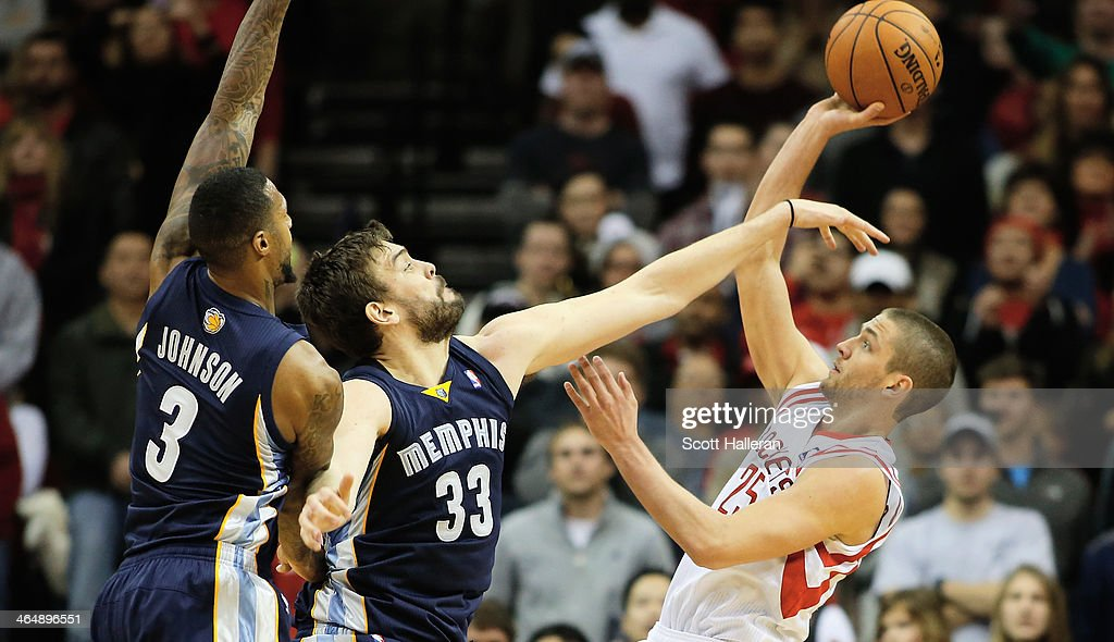 <a gi-track='captionPersonalityLinkClicked' href=/galleries/search?phrase=Chandler+Parsons&family=editorial&specificpeople=4249869 ng-click='$event.stopPropagation()'>Chandler Parsons</a> #25 of the Houston Rockets takes a shot against <a gi-track='captionPersonalityLinkClicked' href=/galleries/search?phrase=Marc+Gasol&family=editorial&specificpeople=661205 ng-click='$event.stopPropagation()'>Marc Gasol</a> #33 and James Johnson #3 of the Memphis Grizzlies during the game at the Toyota Center on January 24, 2014 in Houston, Texas.