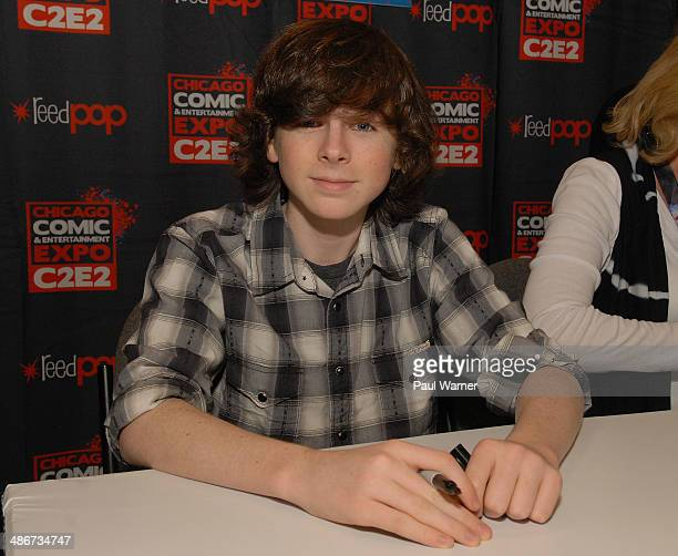Chandler Riggs from the TV show the Walking Dead attends the 2014 Chicago Comic and Entertainment Expo at McCormick Place on April 25 2014 in Chicago...