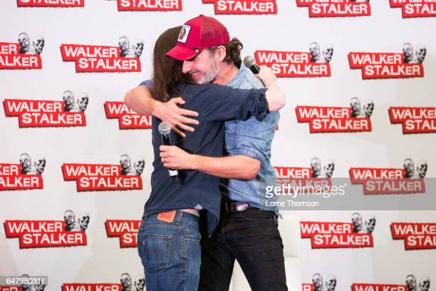 Chandler Riggs is embraced by Andrew Lincoln on day one of the 'Walker Stalker' convention at London Olympia on March 4 2017 in London United Kingdom