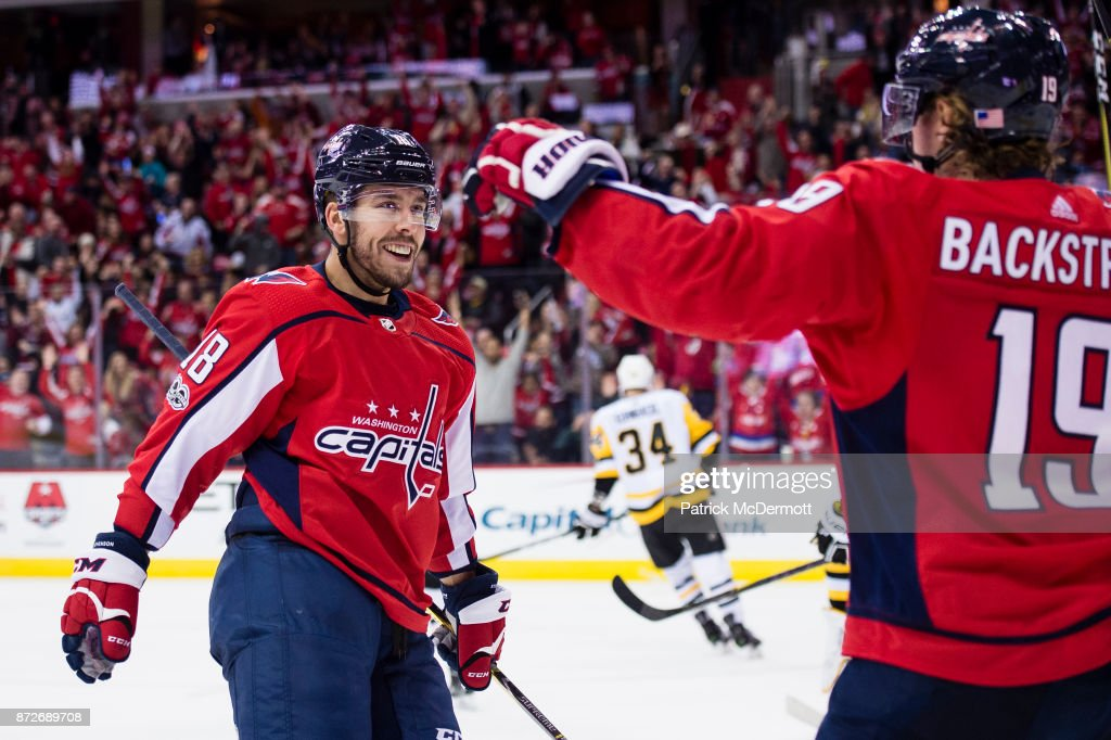 Chandler Stephenson #18 of the Washington Capitals celebrates with Nicklas Backstrom #19 after scoring a third period goal against the Pittsburgh Penguins at Capital One Arena on November 10, 2017 in Washington, DC.