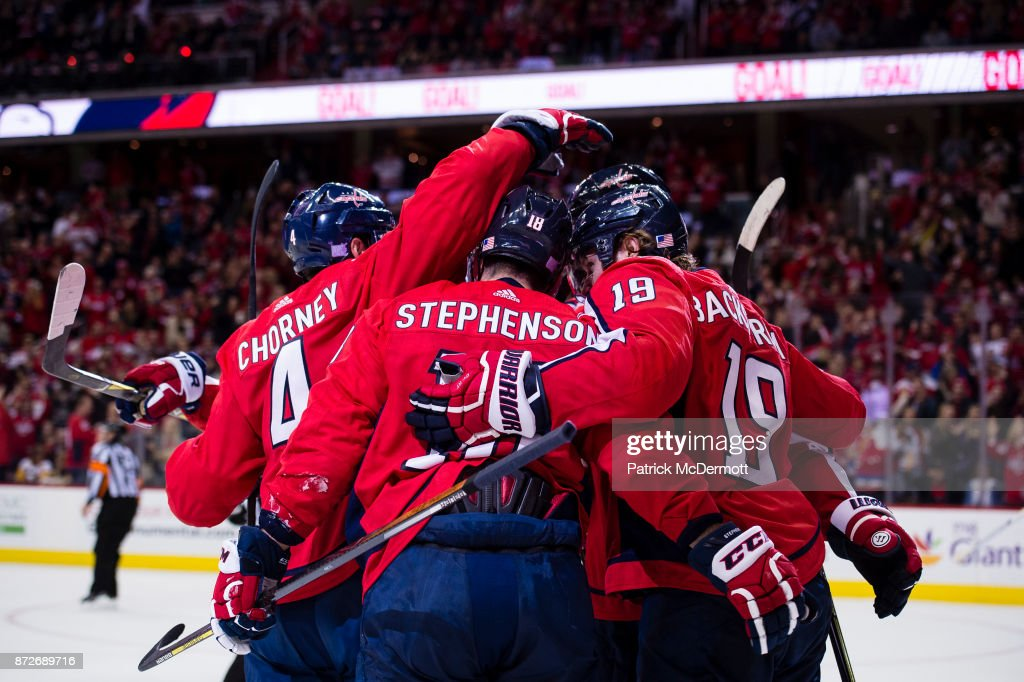 Chandler Stephenson #18 of the Washington Capitals celebrates with his teammates after scoring a third period goal against the Pittsburgh Penguins at Capital One Arena on November 10, 2017 in Washington, DC.