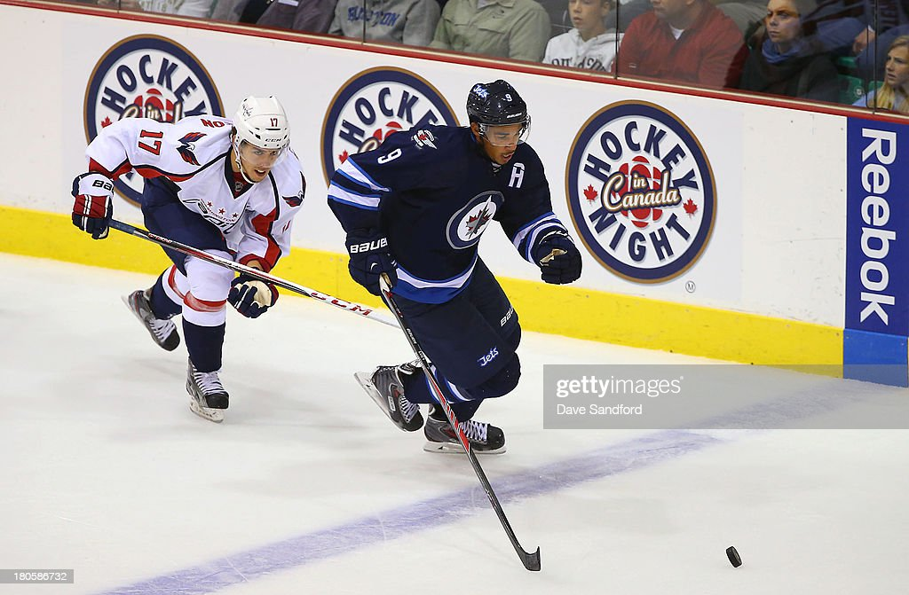 Chandler Stephenson #17 of the Washington Capitals skates after <a gi-track='captionPersonalityLinkClicked' href=/galleries/search?phrase=Evander+Kane&family=editorial&specificpeople=4303789 ng-click='$event.stopPropagation()'>Evander Kane</a> #9 of the Winnipeg Jets during Kraft Hockeyville Day 2 at Yardman Arena on September 14, 2013 in Belleville, Ontario, Canada.