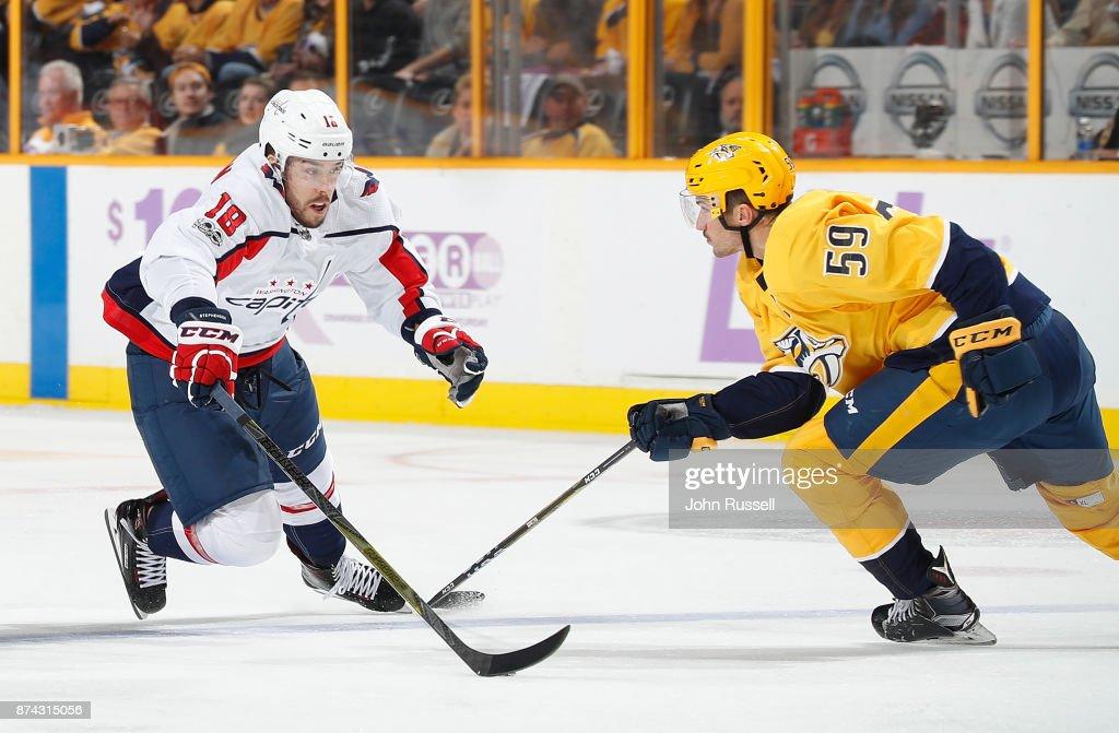 Chandler Stephenson #18 of the Washington Capitals skates against Roman Josi #59 of the Nashville Predators during an NHL game at Bridgestone Arena on November 14, 2017 in Nashville, Tennessee.