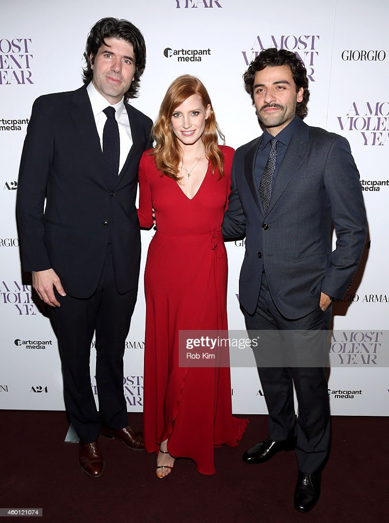 J. C. Chandor, <a gi-track='captionPersonalityLinkClicked' href=/galleries/search?phrase=Jessica+Chastain&family=editorial&specificpeople=653192 ng-click='$event.stopPropagation()'>Jessica Chastain</a> and <a gi-track='captionPersonalityLinkClicked' href=/galleries/search?phrase=Oscar+Isaac&family=editorial&specificpeople=2275888 ng-click='$event.stopPropagation()'>Oscar Isaac</a> attend Giorgio Armani Presents The New York Premiere Of A24's 'A Most Violent Year' at Florence Gould Hall Theater on December 7, 2014 in New York City.
