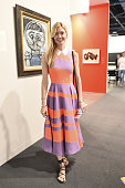 Chandra Johnson is seen wearing a Roksanda Ilincic dress in front of Picasso from the Hammer Gallery during Art Basel Miami Beach at the Miami Beach...