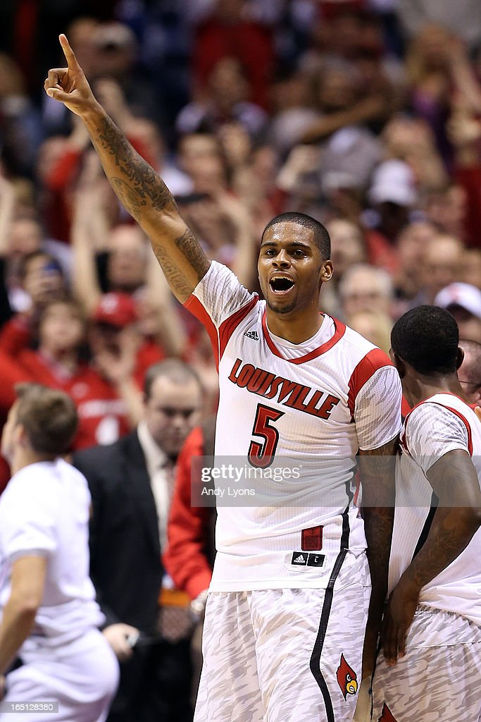 Chane Behanan (wearing the #5 jersey belonging to teammate Kevin Ware) #21 of the Louisville Cardinals celebrates late in the second half against the Duke Blue Devils during the Midwest Regional Final round of the 2013 NCAA Men's Basketball Tournament at Lucas Oil Stadium on March 31, 2013 in Indianapolis, Indiana. Ware suffered a compound leg fracture in the first half.