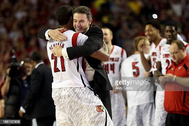 Chane Behanan and head coach Rick Pitino of the Louisville Cardinals celebrate after they won 8276 against the Michigan Wolverines during the 2013...