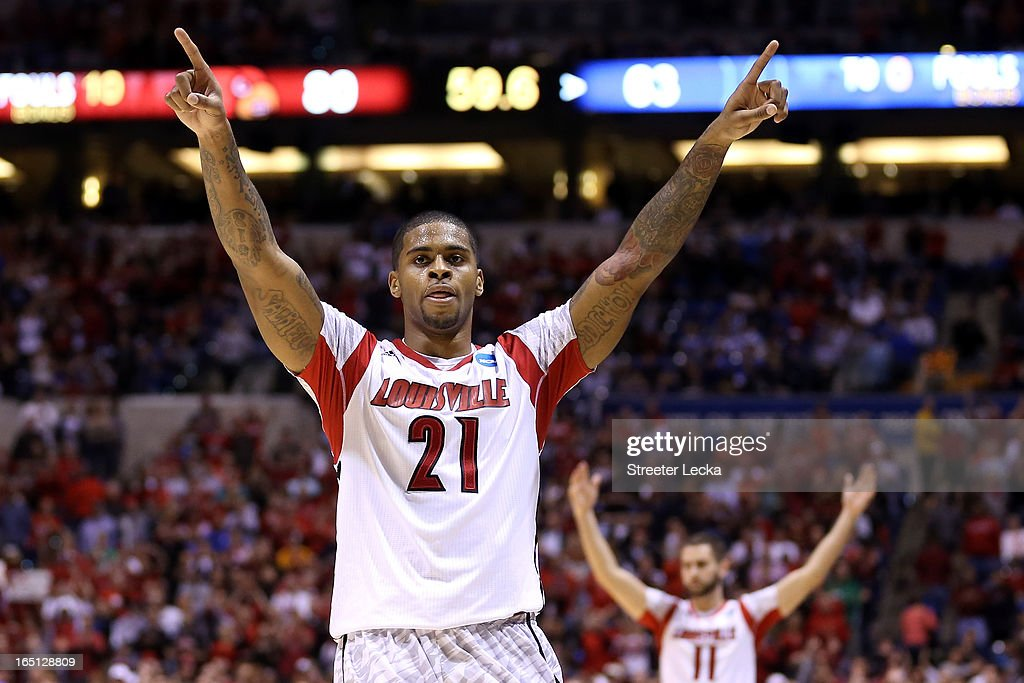 Chane Behanan #21 and Luke Hancock #11 of the Louisville Cardinals celebrate in the final minute against the Duke Blue Devils during the Midwest Regional Final round of the 2013 NCAA Men's Basketball Tournament at Lucas Oil Stadium on March 31, 2013 in Indianapolis, Indiana.
