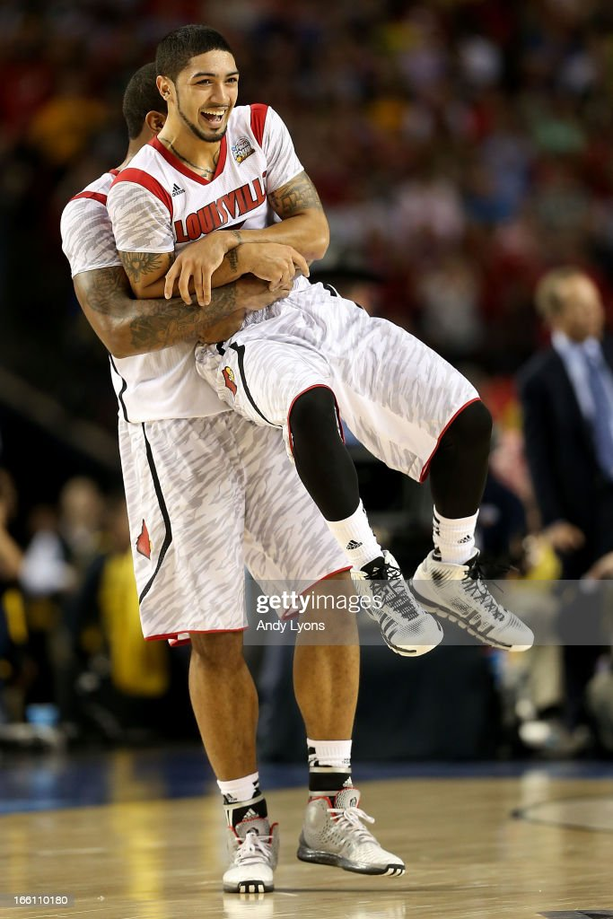 Chane Behanan #21 and Peyton Siva #3 of the Louisville Cardinals celebrate their 82-76 win against the Michigan Wolverines during the 2013 NCAA Men's Final Four Championship at the Georgia Dome on April 8, 2013 in Atlanta, Georgia.