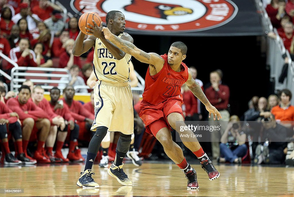 Chane Behanan #24 of the Louisville Cardinals and Jerian Grant #22 of the Notre Dame Fighting Irish battle for a loose ball at KFC YUM! Center on March 9, 2013 in Louisville, Kentucky.