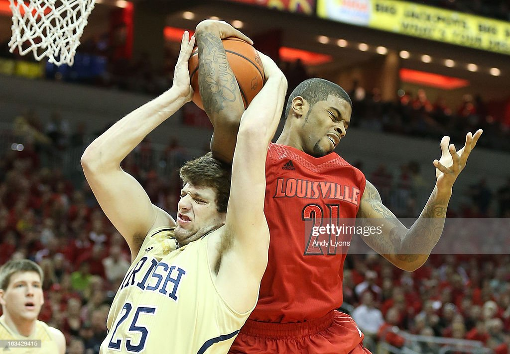 Chane Behanan #24 of the Louisville Cardinals and Tom Knight #25 of the Notre Dame Fighting Irish battle for a rebound at KFC YUM! Center on March 9, 2013 in Louisville, Kentucky.