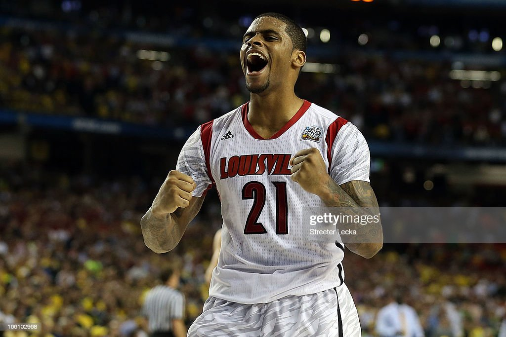 Chane Behanan #21 of the Louisville Cardinals celebrates their 82-76 win against the Michigan Wolverines during the 2013 NCAA Men's Final Four Championship at the Georgia Dome on April 8, 2013 in Atlanta, Georgia.
