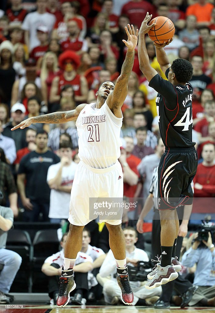 Chane Behanan #21 of the Louisville Cardinals defends the shot of JaQuon Parker #44 of the Cincinnati Bearcats during the game at KFC YUM! Center on March 4, 2013 in Louisville, Kentucky.
