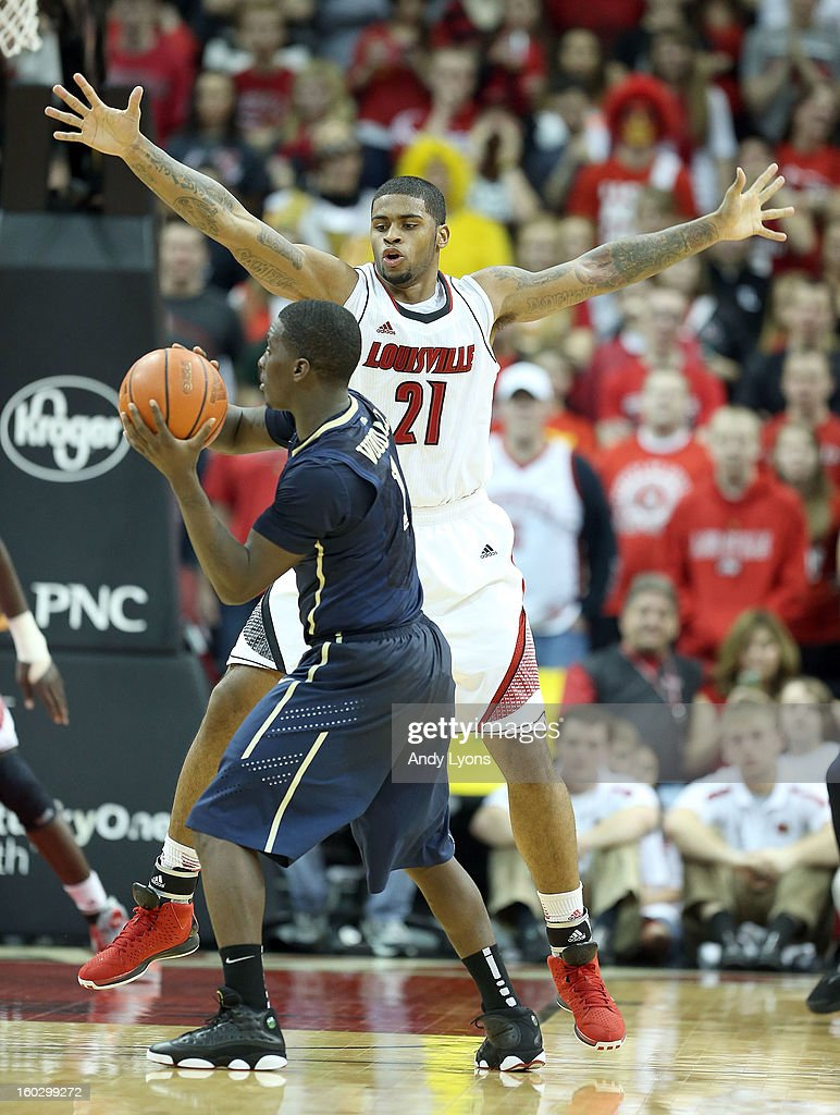 Chane Behanan #21 of the Louisville Cardinals defends Tray Woodall #1 of the Pittsburgh Panthers during the game at KFC YUM! Center on January 28, 2013 in Louisville, Kentucky.