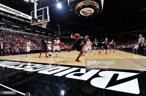 Chane Behanan of the Louisville Cardinals dives for a rebound against the Western Kentucky Hilltoppers at Bridgestone Arena on December 22 2012 in...