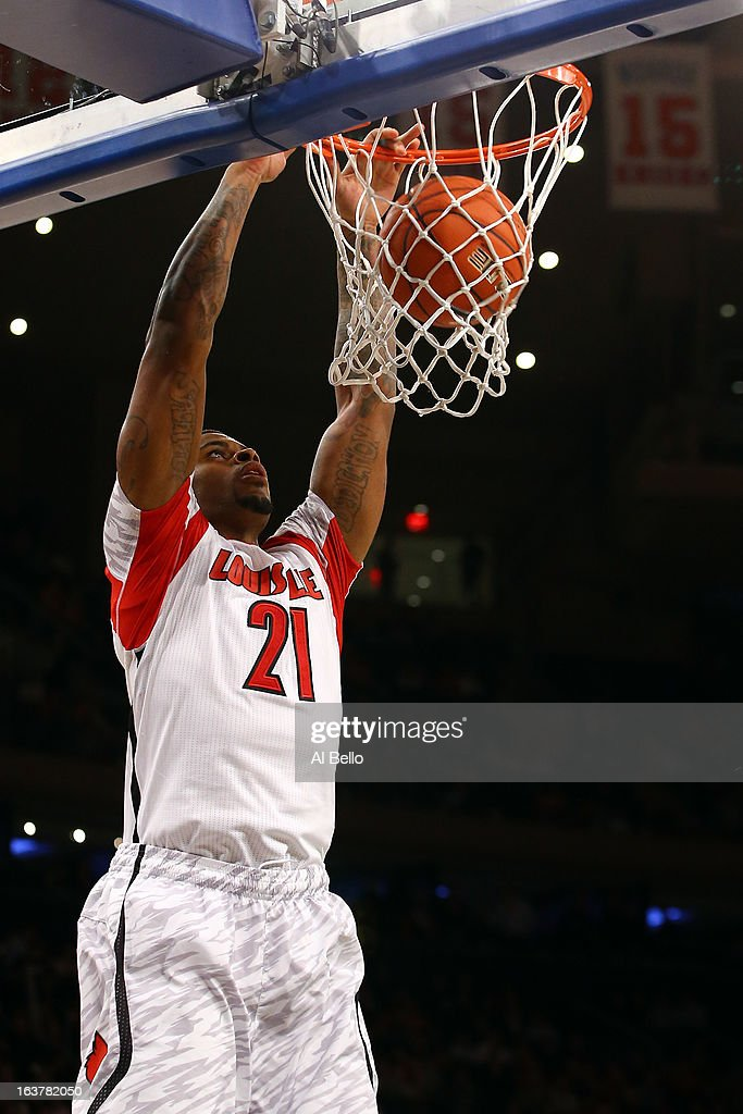 Chane Behanan #21 of the Louisville Cardinals dunks against the Notre Dame Fighting Irish during the semifinals of the Big East Men's Basketball Tournament at Madison Square Garden on March 15, 2013 in New York City.