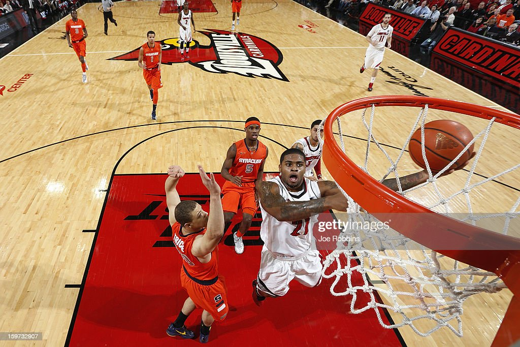 Chane Behanan #21 of the Louisville Cardinals goes to the basket against <a gi-track='captionPersonalityLinkClicked' href=/galleries/search?phrase=Brandon+Triche&family=editorial&specificpeople=6516120 ng-click='$event.stopPropagation()'>Brandon Triche</a> #20 of the Syracuse Orange during the game at KFC Yum! Center on January 19, 2013 in Louisville, Kentucky. Syracuse defeated Louisville 70-68.