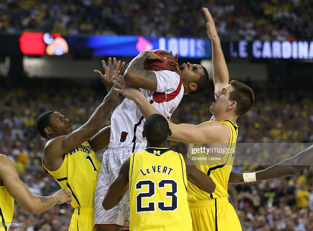 Chane Behanan #21 of the Louisville Cardinals goes up for a shot against Glenn Robinson III #1, Caris LeVert #23 and Mitch McGary #4 of the Michigan Wolverines in the second half during the 2013 NCAA Men's Final Four Championship at the Georgia Dome on April 8, 2013 in Atlanta, Georgia.