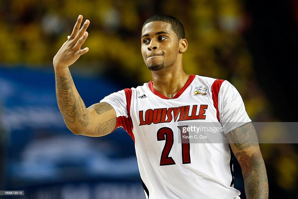 Chane Behanan #21 of the Louisville Cardinals holds up five fingers for injured teammate Kevin Ware after the Cardinals defeat the Wichita State Shockers 72-68 during the 2013 NCAA Men's Final Four Semifinal at the Georgia Dome on April 6, 2013 in Atlanta, Georgia.