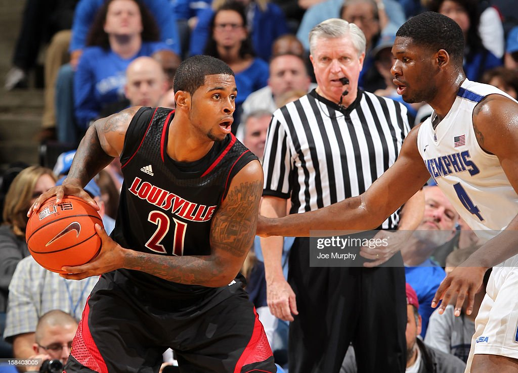 Chane Behanan #21 of the Louisville Cardinals looks to drive against Adonis Thomas #4 of the Memphis Tigers on December 15, 2012 at FedExForum in Memphis, Tennessee.