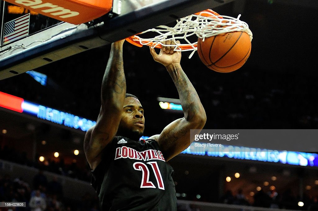 Chane Behanan #21 of the Louisville Cardinals scores against the Memphis Tigers during a game at FedExForum on December 15, 2012 in Memphis, Tennessee.