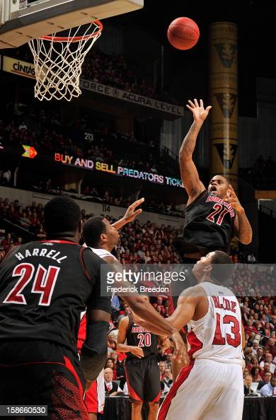 Chane Behanan of the Louisville Cardinals takes a shot over Percy Blade of the Western Kentucky Hilltoppers at Bridgestone Arena on December 22 2012...
