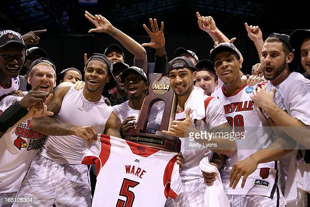 Chane Behanan Russ Smith Peyton Siva Wayne Blackshear and Luke Hancock of the Louisville Cardinals celebrate with the Midwest regional champion...