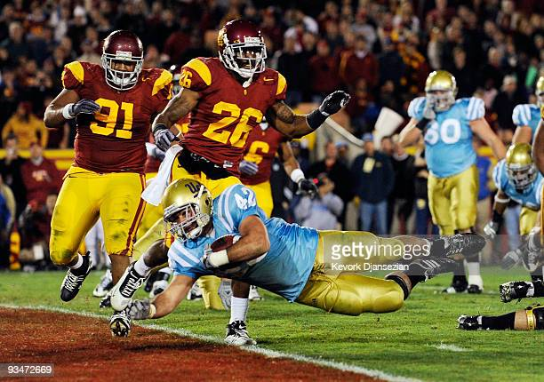 Chane Moline of the UCLA Bruins scores a touch down against USC Trojans during the fourth quarter of the NCAA college football game at Los Angeles...