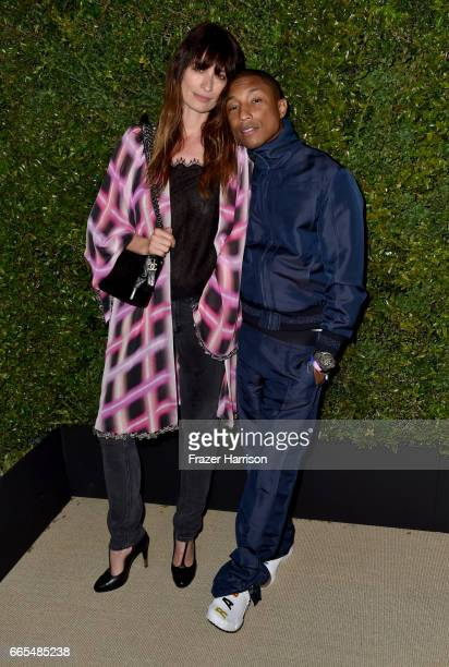 Chanel Ambassadors Caroline de Maigret and Pharrell Williams attend the celebration of Chanel's Gabrielle Bag hosted by Caroline De Maigret and...