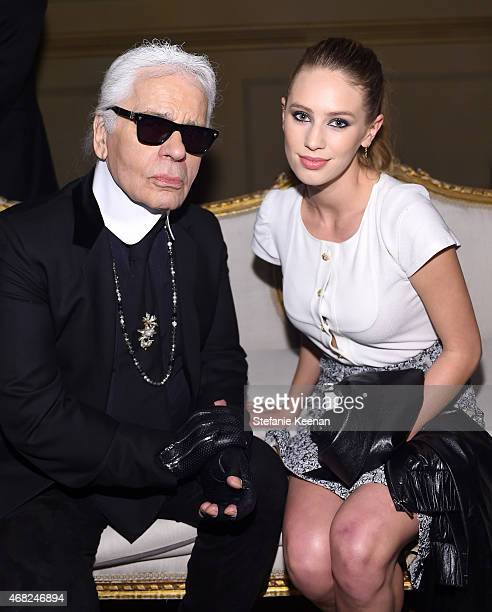 Chanel Artistic Director Karl Lagerfeld and Dylan Penn attend the CHANEL ParisSalzburg 2014/15 Metiers d'Art Collection in New York City at the Park...