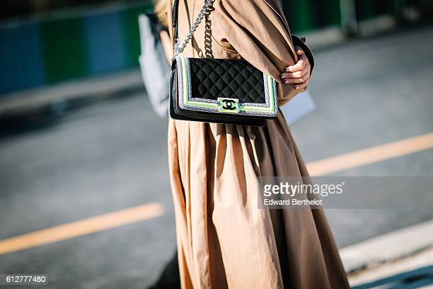 Chanel bag is seen outside the Chanel show during Paris Fashion Week Spring Summer 2017 at Grand Palais on October 4 2016 in Paris France