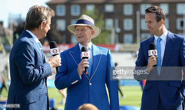 Chanel Five commentator Geoffrey Boycott wears a blue Cricket United jacket alongside Michael Vaughan and Mark Nicholas ahead of day three of the 5th...