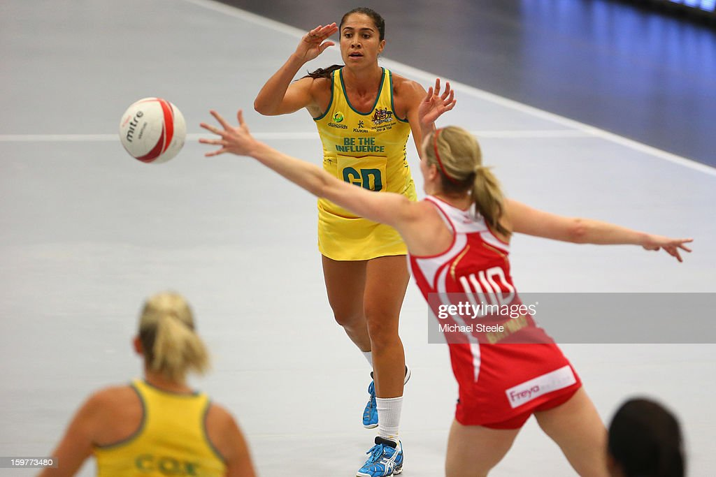 Chanel Gomes (C) of Australia passes during the England v Australia International Netball Series match at the University of Bath on January 20, 2013 in Bath, England.