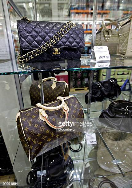 A Chanel handbag retailing for $199999 top sits on display inside a Costco store in New York US on Wednesday Nov 11 2009 The store Costco's first in...