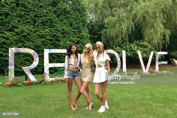 Chanel Iman Elsa Hosk and Josephine Skriver attend the FIJI Water at #REVOLVEintheHamptons 2017 on July 22 2017 in Bridgehampton New York
