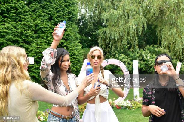 Chanel Iman Elsa Hosk Travis Scott and Josephine Skriver and Michael Mente attend the FIJI Water at #REVOLVEintheHamptons 2017 on July 22 2017 in...
