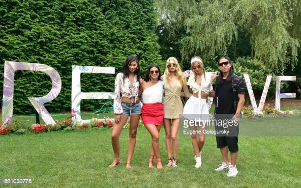 Chanel Iman Raissa Gerona Elsa Hosk Josephine Skriver and Michael Mente attend the FIJI Water at #REVOLVEintheHamptons 2017 on July 22 2017 in...