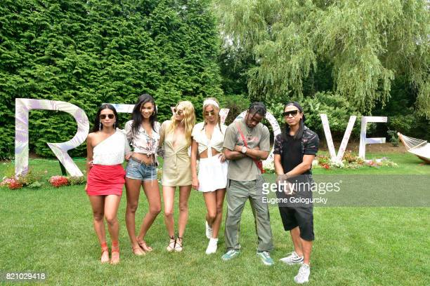 Chanel Iman Raissa Gerona Elsa Hosk Josephine Skriver Travis Scott and Michael Mente attend the FIJI Water at #REVOLVEintheHamptons 2017 on July 22...