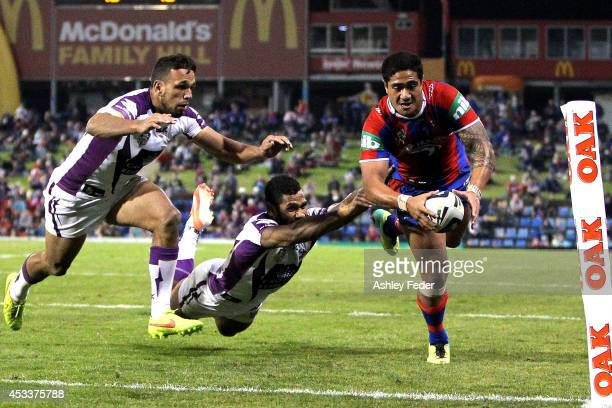 Chanel Mata'Utia of Knights scores a try with the Storm defence in frame the during the round 22 NRL match between the Newcastle Knights and the...